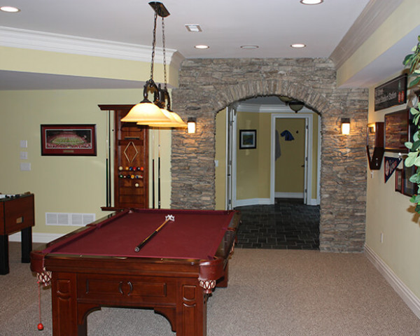 Basement Game room with Stone Arch