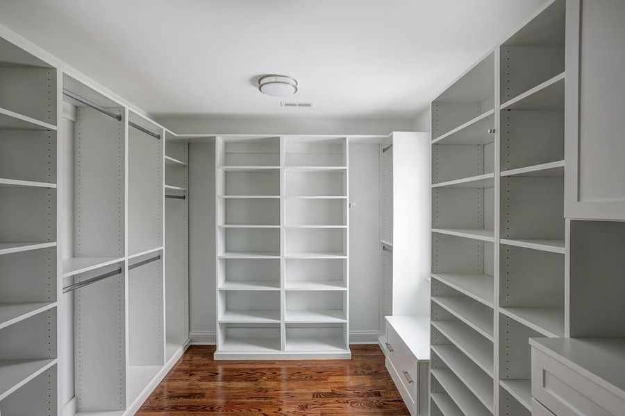 A spacious master walk-in closet.