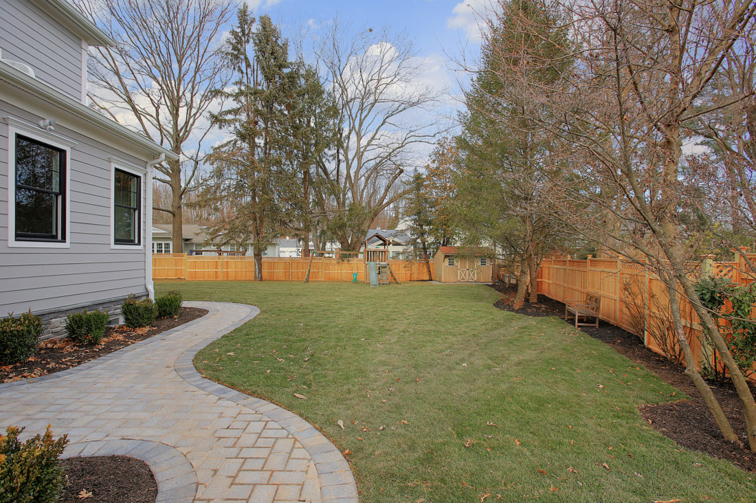 premier-design-custom-home-builders-nj-exterior-patio-yard-lot